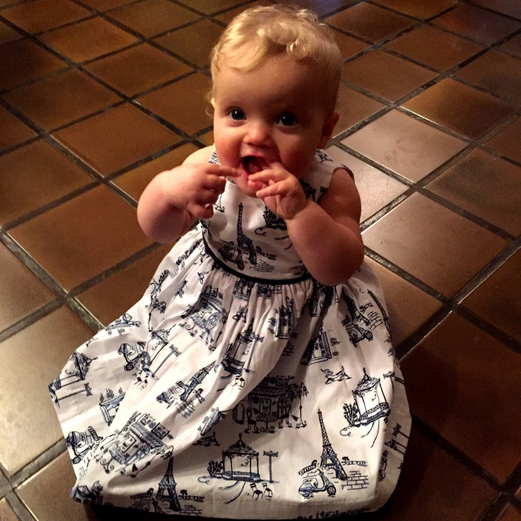 Dressed up in her Paris dress for a night on the town.  LeBeef got this for her before she was born.
