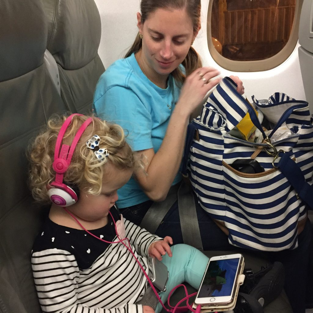 This lil girl was a saint on these flights.  She watched shows on a phone, wore headphones, and napped and snacked like a champ!
